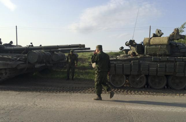 A picture shows a military convoy on the road side of the Russian southern town of Matveev Kurgan