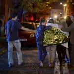 people-walk-outside-a-nightclub-following-an-explosion-in-bucharest