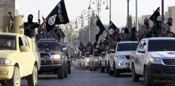 militant-islamist-fighters-parade-on-military-vehicles-along-the-streets-of-northern-raqqa-province