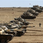 turkish-army-tanks-take-up-position-on-the-turkish-syrian-border-near-the-southeastern-town-of-suruc-in-sanliurfa-province