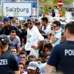 file-photo-of-german-police-officers-standing-in-front-of-migrants-waiting-to-cross-the-border-from-austria-to-germany-near-freilassing