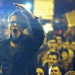a-demonstrator-shouts-anti-corruption-slogans-during-a-street-protest-in-bucharest