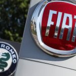 logos-of-fiat-and-alfa-romeo-are-seen-outside-a-car-dealer-amid-the-coronavirus-disease-covid-19-outbreak-in-brussels